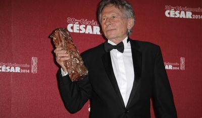 FILE - In this Friday Feb. 28, 2014 file picture, Polish-French film director Roman Polanski holds his best director award during the 39th French Cesar Awards Ceremony in Paris, France. Filmmaker Roman Polanski has decided not to preside over the French equivalent of the Oscars, after protests from France's women's rights minister and feminist groups because of decades-old U.S. sex charges. (AP Photo/Lionel Cironneau, File)