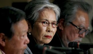 Japan Golf Council Chairwoman Eiko Ohya, center, listens to a reporter's question with vice chairmen, Yutaka Morohoshi, left, and Masayuki Tamaki, during a press conference at the Foreign Correspondents' Club of Japan in Tokyo, Tuesday, Jan. 24, 2017. The course that will host the 2020 Olympic golf tournament says it is open to changing its membership policy to include women. The Kasumigaseki Country Club came under scrutiny recently when the International Olympic Committee inquired about the club's membership practice. The issue surfaced in mid-January when Tokyo Gov. Yuriko Koike urged Kasumigaseki to admit women as full members. (AP Photo/Shizuo Kambayashi)