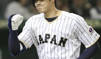 FILE - In this Nov. 12, 2016 file photo, Japan's designated hitter Shohei Otani reacts after hitting a solo home run off Netherlands' starter Jair Jurrjens in the fifth inning of their international exhibition series baseball game at Tokyo Dome in Tokyo. All-Star pitcher Otani will headline Japan's bid for a third title at the World Baseball Classic. The 22-year-old Otani was among 27 players named to Japan's squad on Tuesday, Jan. 24, 2017, by Samurai Japan manager Hiroki Kokubo. (AP Photo/Koji Sasahara, File)