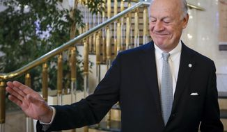 U.N. Special Envoy for Syria Staffan de Mistura gestures as he arrives to attend the talks on Syrian peace in Astana, Kazakhstan, Tuesday, Jan. 24, 2017. The face-to-face meeting in Kazakhstan's capital is the latest in a long line of diplomatic initiatives aimed at ending the nearly 6-year-old civil war. (AP Photo/Sergei Grits)
