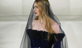 A model wears a creation by Alexis Mabille during his Haute Couture Spring-Summer 2017 fashion collection presented in Paris, Tuesday, Jan. 24, 2017. (AP Photo/Francois Mori)