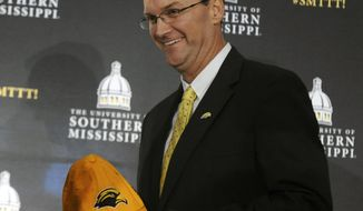 Southern Mississippi's new athletic director Jon Gilbert is given a Golden Eagle hat during a press conference in the Jim and Thomas Duff Athletic Center on Tuesday, Jan. 24, 2017, in Hattiesburg, Miss. (Susan Broadbridge/Hattiesburg American via AP)