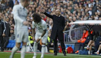 Real Madrid's head coach Zinedine Zidane gives instructions from the side line during a Spanish La Liga soccer match between Real Madrid and Malaga at the Santiago Bernabeu stadium in Madrid, Saturday, Jan. 21, 2017. (AP Photo/Francisco Seco)