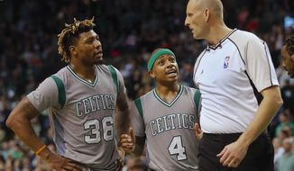 Boston Celtics' Marcus Smart (36) and Isaiah Thomas argue a call against them with referee Eric Dalen (37) during overtime of Boston's 127-123 loss to the Portland Trail Blazers in an NBA basketball game in Boston Saturday, Jan. 21, 2017. (AP Photo/Winslow Townson)