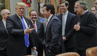 President Donald Trump points to Ford Motors CEO Mark Fields, center, at the start of a meeting with automobile leaders in the Roosevelt Room of the White House in Washington, Tuesday, Jan. 24, 2017. Also at the meeting are Fiat Chrysler Automobiles CEO Sergio Marchionne, right, and White House Senior Adviser Jared Kushner, second from the right. (AP Photo/Pablo Martinez Monsivais)