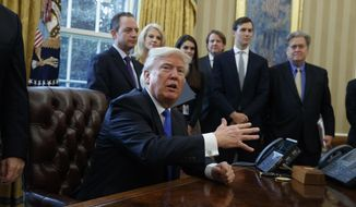 President Donald Trump talks with reporters in the Oval Office of the White House in Washington, Tuesday, Jan. 24, 2017, before signing an executive order on the Keystone XL pipeline. (AP Photo/Evan Vucci)