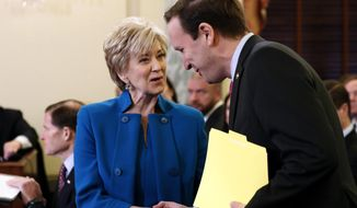 Small Business Administration Administrator-designate, former wrestling entertainment executive, Linda McMahon shakes hands with Sen. Chris Murphy, D-Conn. on Capitol Hill in Washington, Tuesday, Jan. 24, 2017, prior to her confirmation before the Senate Small Business and Entrepreneurship Committee. (AP Photo/Alex Brandon)