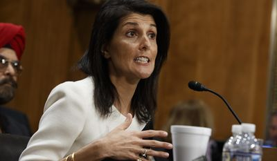 FILE - In this Jan. 18, 2017 file photo, UN Ambassador-designate, South Carolina Gov. Nikki Haley testifies on Capitol Hill in Washington at her confirmation hearing before the Senate Foreign Relations Committee. The Senate Foreign Relations Committee has overwhelmingly approved Haley's nomination to be U.S. ambassador to the United Nations. (AP Photo/Evan Vucci, File)