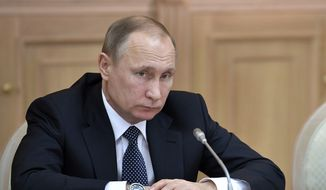 Russian President Vladimir Putin listens during a meeting of the council of trustees of the Moscow State University (MGU) in Moscow on Wednesday, Jan. 25, 2017. On Jan. 25 Russia marks Students' Day. (Alexei Nikolsky/Pool Photo via AP) ** FILE **