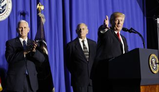 President Donald Trump, accompanied by Vice President Mike Pence and Homeland Security Secretary John F. Kelly, gestures as he speaks at the Homeland Security Department in Washington, Wednesday, Jan. 25, 2017. (AP Photo/Pablo Martinez Monsivais)