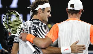 Switzerland's Roger Federer, left, is congratulated by Germany's Mischa Zverev during their quarterfinal at the Australian Open tennis championships in Melbourne, Australia, Tuesday, Jan. 24, 2017. (AP Photo/Dita Alangkara)