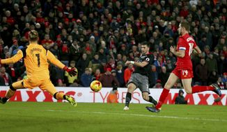 Southampton's Shane Long, center, scores during the English League Cup semifinal 2nd leg soccer match between Liverpool and Southampton at Anfield stadium in Liverpool, England, Wednesday, Jan. 25, 2017. (AP Photo/Dave Thompson)