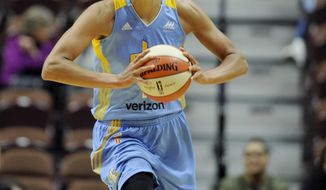 FILE - In this May 5, 2016, file photo, Chicago Sky's Elena Delle Donne looks to pass during the first half of a WNBA basketball game in Uncasville, Conn. Delle Donne is returning home from China because of a flare up of Lyme Disease. The Chicago Sky star announced in a news conference Wednesday, Jan. 25, 2017,  that she would be coming back to the United States. (AP Photo/Jessica Hill, File)