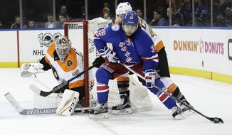 Philadelphia Flyers goalie Steve Mason (35) defends the goal from New York Rangers' Mats Zuccarello (36) during the second period of an NHL hockey game Wednesday, Jan. 25, 2017, in New York. (AP Photo/Frank Franklin II)