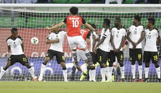 Egypt's Mohamed Salah, front, scores a goal during the African Cup of Nations Group D soccer match between Egypt and Ghana at the Stade de Port-Gentil, Gabon, Wednesday Jan. 25, 2017. (AP Photo/Sunday Alamba)