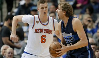New York Knicks forward Kristaps Porzingis (6) of Latvia defends as Dallas Mavericks' Dirk Nowitzki of Germany prepares to take a shot in the first half of an NBA basketball game, Wednesday, Jan. 25, 2017, in Dallas. (AP Photo/Tony Gutierrez)