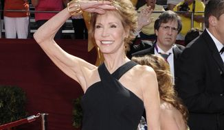 FILE - This Sept. 21, 2008 file photo shows Mary Tyler Moore at the 60th Primetime Emmy Awards in Los Angeles. Moore died Wednesday, Jan. 25, 2017, at age 80. (AP Photo/Chris Pizzello, File)