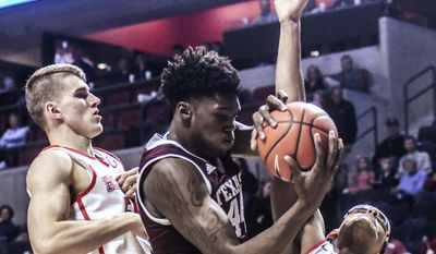 Texas A&M forward Robert Williams (44) grabs a rebound between Mississippi forwards Justas Furmanavicius (50) and Sebastian Saiz (11) during an NCAA college basketball game Wednesday, Jan. 25, 2017, in Oxford, Miss. (Bruce Newman/The Oxford Eagle via AP)