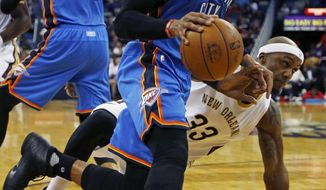 Oklahoma City Thunder guard Russell Westbrook, center, dribbles past New Orleans Pelicans forward Dante Cunningham (33) in the first half of an NBA basketball game in New Orleans, Wednesday, Jan. 25, 2017. (AP Photo/Max Becherer)