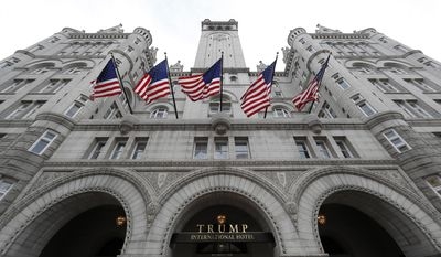 FILE - In this Dec. 21, 2106 file photo, the Trump International Hotel in Washington. An electrical subcontractor who worked on the Trump International Hotel in Washington has sued a company owned by President Donald Trump for more than $2 million, alleging it was not fully paid. (AP Photo/Alex Brandon, File)