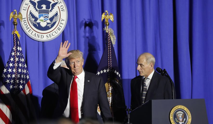 President Donald Trump, followed by Homeland Security Secretary John F. Kelly, waves as he steps off stage after speaking at the Homeland Security Department in Washington, Wednesday, Jan. 25, 2017.  (AP Photo/Pablo Martinez Monsivais)