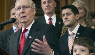 House Speaker Paul Ryan of Wisconsin and others listen as Senate Majority Leader Mitch McConnell of Kentucky speaks on Capitol Hill in Washington on Dec. 8, 2016. (Associated Press) **FILE**