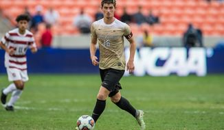 December 11, 2016: Wake Forest midfielder Ian Harkes (16) controls the ball during the 2nd overtime period of the NCAA men's soccer Championship game between the Wake Forest Demon Deacons and the Stanford Cardinal at BBVA Compass Stadium in Houston, TX. Stanford won 5-4 on a penalty kick shootout after two overtime periods ended with a 0-0 score...Trask Smith/CSM (Cal Sport Media via AP Images)