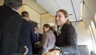 White House Official photographer Shealah Craighead talks with members of the media before President Donald Trump's departure from Andrews Air Force One, Md., Thursday, Jan. 26, 2017, to Philadelphia. (AP Photo/Pablo Martinez Monsivais)