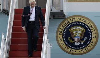 President Donald Trump walks off Air Force One, Thursday, Jan. 26, 2017, after arriving at the Philadelphia International Airport in Philadelphia, before speaking at the Republican Congressional retreat. (AP Photo/Matt Slocum)