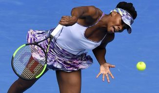 United States' Venus Williams serves to compatriot Coco Vandeweghe during their semifinal at the Australian Open tennis championships in Melbourne, Australia, Thursday, Jan. 26, 2017. (AP Photo/Andy Brownbill)