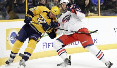 Nashville Predators left wing Cody McLeod (55) and Columbus Blue Jackets defenseman Seth Jones (3) fight for the puck during the second period of an NHL hockey game Thursday, Jan. 26, 2017, in Nashville, Tenn. (AP Photo/Mark Humphrey)