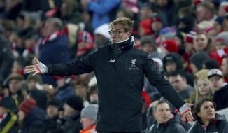 Liverpool's head coach Juergen Klopp gestures as he watches during the English League Cup semifinal 2nd leg soccer match between Liverpool and Southampton at Anfield stadium in Liverpool, England, Wednesday, Jan. 25, 2017. (AP Photo/Dave Thompson)