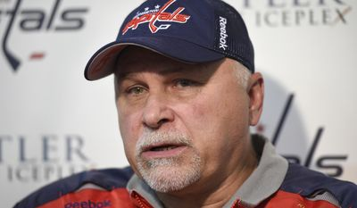 FILE - In this Sept. 18, 2015, file photo, Washington Capitals head coach Barry Trotz talks to reporters during Media Day at NHL hockey training camp in Arlington, Va. A five-day bye week for each team is a new wrinkle added to the NHL this season so players can get a breather during the second half of a grueling, 82-game grind. Trotz is concerned about injuries when a team coming off a bye plays an opponent that has been in action. (AP Photo/Nick Wass, File)