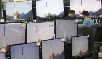 FILE - In this Aug. 24, 2016 file photo, TV screens show file footage of a North Korea's ballistic missile that North Korea claimed to have launched from underwater, at the Yongsan Electronic store in Seoul, South Korea. China has released a new list of items banned for export to North Korea, following a new round of United Nations sanctions and complaints from President Donald Trump that Beijing was not doing enough to pressure its communist neighbor. A statement from the Commerce Ministry late Wednesday, Jan. 25, 2017, said the items included dual-use technologies that could aid the North's programs to develop nuclear, chemical and biological weapons as well as the missiles to deliver them. (AP Photo/Ahn Young-joon, File)