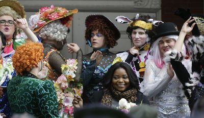 Actress Octavia Spencer, right center, bottom row, poses with members of Harvard's Hasty Pudding Theatricals after a parade to honor Spencer as the Hasty Pudding Theatricals Woman of the Year Thursday, Jan. 26, 2017, in Cambridge, Mass. (AP Photo/Stephan Savoia)