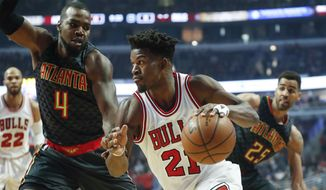 Chicago Bulls forward Jimmy Butler (21) drives to the basket against Atlanta Hawks forward Paul Millsap (4) during the first half of an NBA basketball game, Wednesday, Jan. 25, 2017, in Chicago. (AP Photo/Kamil Krzaczynski) **FILE**