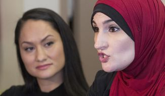 FILE - In this Jan. 9, 2017 file photo Linda Sarsour, right, and Carmen Perez, co-chairs of the Women's March on Washington, speak during an interview in New York. In the days since Sarsour helped organize the massive march on Washington the day after Donald Trump's inauguration, the Brooklyn-born, hijab-wearing activist has been targeted on the Internet by false reports that she supports Islamic State militants and favors replacing the U.S. legal system with Islamic religious law.  (AP Photo/Mark Lennihan, File)