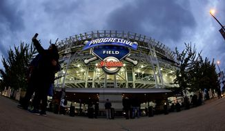 FILE - In this Oct. 25, 2016, file photo, fans arrive for Game 1 of the Major League Baseball World Series between the Cleveland Indians and the Chicago Cubs, at Progressive Field in Cleveland. A person familiar with the decision says the Cleveland Indians will host the 2019 All-Star Game at Progressive Field. The team will hold a news conference on Friday, Jan. 27, 2017,  to formally announce the event last held in Cleveland in 1997, the person told The Associated Press on Thursday, speaking on condition of anonymity because the announcement had not been made.(AP Photo/Charlie Riedel, File)