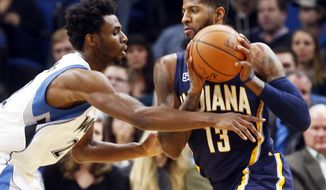 Indiana Pacers' Paul George, right, drives as Minnesota Timberwolves' Andrew Wiggins defends during the first quarter of an NBA basketball game Thursday, Jan. 26, 2017, in Minneapolis. (AP Photo/Jim Mone)