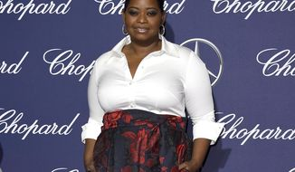 FILE - In this Monday, Jan. 2, 2017 file photo, Octavia Spencer arrives at the 28th annual Palm Springs International Film Festival Awards Gala in Palm Springs, Calif. Academy Award-winning actress Spencer, fresh off her nomination for a second Oscar, is heading to Massachusetts to pick up yet another award: Woman of the Year by Harvard University's Hasty Pudding Theatricals. Spencer will be honored Thursday, Jan. 26, 2017, with a parade through the streets of Cambridge, followed by a roast and the presentation of her pudding pot. (Photo by Jordan Strauss/Invision/AP, File)