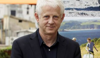 """FILE - In this Oct. 21, 2013 file photo, British director Richard Curtis, founder of Red Nose Day, poses for the photographers as he present his latest movie """"About Time"""" , in Rome. Comic Relief, Inc. announced Thursday, Jan. 26, 2017, that the 2017 fundraising efforts will culminate with the Red Nose Day TV special on May 25. (AP Photo/Gregorio Borgia, FIle)"""