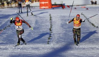 Winner Johannes Rydzek of Germany, left, and second placed Eric Frenzel of Germany cross the finish line during the Nordic Combined World Cup competition in Seefeld, Austria, Friday, Jan. 27, 2017. (AP Photo/Matthias Schrader)