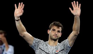 Bulgaria's Grigor Dimitrov waves after losing to Spain's Rafael Nadal in their semifinal at the Australian Open tennis championships in Melbourne, Australia, early Saturday, Jan. 28, 2017. (AP Photo/Aaron Favila)