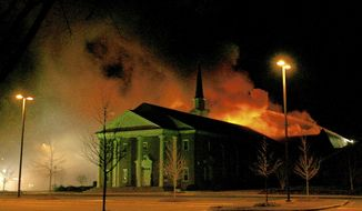 ADVANCE FOR USE SUNDAY, JAN. 29 - In this  Jan. 7, 2007 photo, firefighters battle a blaze set by an arsonist that burns The Memorial Baptist Church in Greenville, N.C. When fire swept through The Memorial Baptist Church a decade ago, Randy McKinney had only been pastor there for six months. He was still working to get to know many people. But through that fire, McKinney forged friendships outside the walls of the church, friendships that most likely never would have been kindled if not for the tragedy.  (The Daily Reflector/The Daily Reflector via AP)