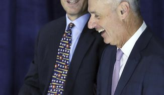 Cleveland Indians Chairman and CEO Paul Dolan, left, talks with Major League Baseball commissioner Rob Manfred after a press conference where Manfred announced that the Indians would host the 90th All-Star Game in 2019 at Progressive Field in Cleveland, Friday, Jan. 27, 2017. (Chuck Crow//The Plain Dealer via AP)