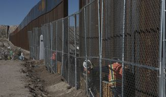 """Workers continue work raising a taller fence in the Mexico-US border separating the towns of Anapra, Mexico and Sunland Park, New Mexico, Wednesday, Jan. 25, 2017. U.S. President Donald Trump says his administration will be working in partnership in Mexico to improve safety and economic opportunity for both countries and will have """"close coordination"""" with Mexico to address drug smuggling. It will set in motion the construction of his proposed border wall, a key promise from his 2016 campaign. (AP Photo/Christian Torres)"""