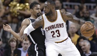 Cleveland Cavaliers' LeBron James (23) drives past Brooklyn Nets' Spencer Dinwiddie (8) duirng the first half of an NBA basketball game, Friday, Jan. 27, 2017, in Cleveland. (AP Photo/Tony Dejak)