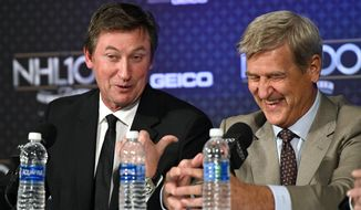 Wayne Gretzky, left, points to Bobby Orr during a news conference prior to an NHL 100 ceremony, Friday, Jan. 27, 2017, in Los Angeles.  (AP Photo/Mark J. Terrill)