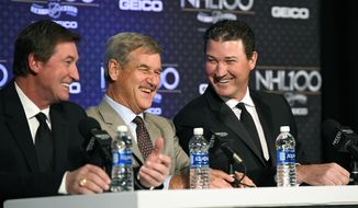 Former NHL hockey players, from left, Wayne Gretzky, Bobby Orr and Mario Lemieux speak during a news conference prior to an NHL 100 ceremony, Friday, Jan. 27, 2017, in Los Angeles. (AP Photo/Mark J. Terrill)