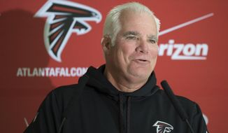 FILE - In this Oct. 22, 2014, file photo, Atlanta Falcons head coach Mike Smith speaks during a press conference about an upcoming game against the Detroit Lions, in Watford, England. Mike Smith never made it to the Super Bowl with the Falcons. Came up 10 yards short. But let's not underestimate the impact he had on the Falcons, who are now just one win away from their first NFL championship. (AP Photo/Tim Ireland, File)